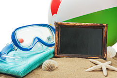 Blackboard on the sand and other things for the beach Stock Image