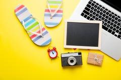 Blackboard, sandals, camera, alarm clock, gift and laptop Stock Photo