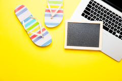 Blackboard, sandals and laptop Stock Image