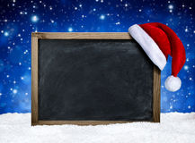 Blackboard with santa hat Stock Photo