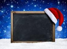 Blackboard with santa hat Stock Photo