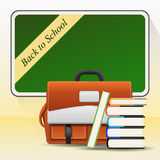 Blackboard with school bag and books Royalty Free Stock Photo