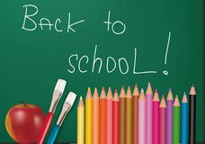 Blackboard with school supplies. Stock Photos