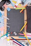 Blackboard and school supplies Stock Images