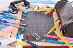 Blackboard and school supplies Royalty Free Stock Photography
