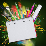 Blackboard with school supplies Stock Photo
