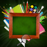 Blackboard with school supplies Stock Image