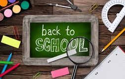 Blackboard with school supplies Royalty Free Stock Photos