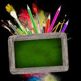 Blackboard with school supplies Royalty Free Stock Image
