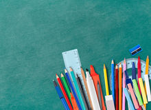 Blackboard and school supplies Royalty Free Stock Photo