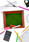 Blackboard with school supplies Stock Photography