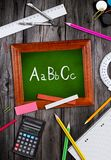 Blackboard with school supplies Royalty Free Stock Photo