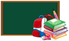 Blackboard and schoolbag with books Royalty Free Stock Images