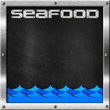 Blackboard for Seafood Menu. Empty blackboard with metal frame and screws, blue waves and text seafood. Template for recipes or seafood menu Royalty Free Stock Images