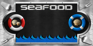 Blackboard for Seafood Menu. Blackboard with a metal frame on a metallic background with kitchen utensils, lifebuoys, seashells and sea waves. Template for Royalty Free Stock Photography