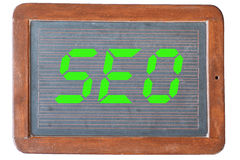 Blackboard SEO. Chalkboard with digital SEO, sign for search engine optimization Royalty Free Stock Photo