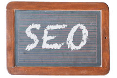 Blackboard SEO. Chalkboard with digital SEO, sign for search engine optimization Stock Photo