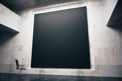 Blackboard side. Side view of a blank blackboard in concrete interior with swivel-chair. Mock up, 3D Render Stock Photo