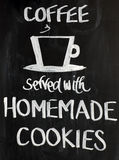 Blackboard Sign. With a cup motif and the words - Coffee served with homemade cookies. White on a black background stock photos
