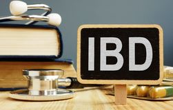 Blackboard with sign inflammatory bowel disease IBD. And stethoscope stock images