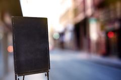Blackboard or signboard in the front store, street view Royalty Free Stock Photo