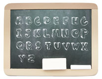 Blackboard with sketchy capital alphabet written on it. Isolated Royalty Free Stock Photos