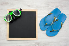 Blackboard with snorkel and summer shoes Stock Image