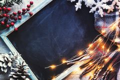 Blackboard with some Christmas decorations royalty free stock photos