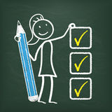 Blackboard Stickwoman Checklist. Blackboard with stickwoman, pencil and a checklist Stock Photos