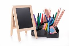 Blackboard and supplies Stock Images