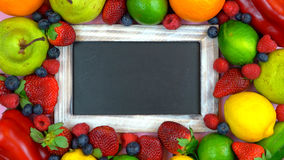 Blackboard surrounded by healthy food, royalty free stock photo