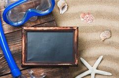 Blackboard and swim mask and snorkel Stock Photo