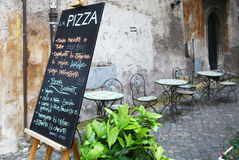 Blackboard & tables of a pizzeria in Rome Royalty Free Stock Photo
