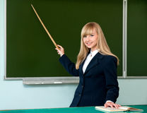 Blackboard and the teacher with a pointer stock photos