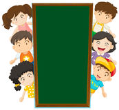 Blackboard template with happy kids in the back Royalty Free Stock Photo