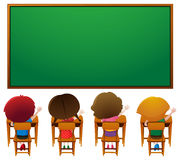 Blackboard template and kids in classroom Royalty Free Stock Image