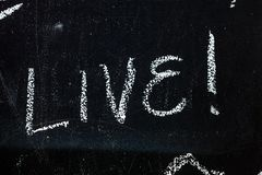 Blackboard with text Live royalty free stock images