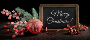 Blackboard with text space and Christmas decorations on black ba Stock Photo