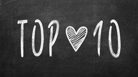 Blackboard with the text TOP 10. Top 10 phrase written with chalk on blackboard Royalty Free Stock Image