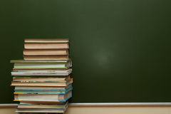 Blackboard and textbooks Stock Photography