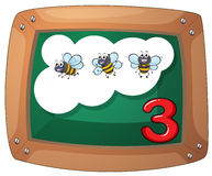 A blackboard with three bees Royalty Free Stock Photography