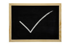 Blackboard with tick Stock Photo