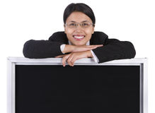 Blackboard to post message below smiling woman Royalty Free Stock Photos