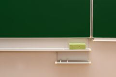 Blackboard and tools in the classroom Royalty Free Stock Photo