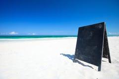 Blackboard on tropical beach Stock Image