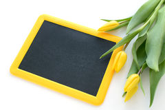 Blackboard with tulips Royalty Free Stock Photo