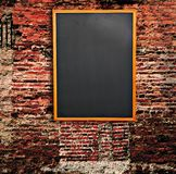 Blackboard on wall Royalty Free Stock Image