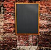Blackboard on wall Royalty Free Stock Image