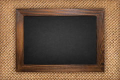 Blackboard on weave background Stock Images