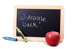 Blackboard with Welcome back message Stock Photo